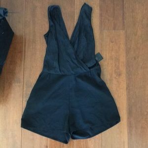 romper with backpockets. Hidden side zipper